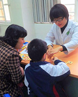 Dr Oahn working with a child and parent